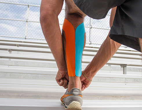 MuscleAidTape Kinesiology Tape applied to runner's calf